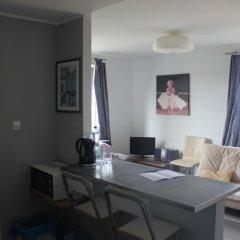 Апартаменты Studiospanie Studio Green Sopot Сопот комната для гостей фото 2