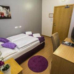 Отель The Capital-Inn Кровать в общем номере с двухъярусной кроватью фото 3