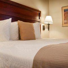 Отель Country Inn & Suites by Radisson, Midway, FL комната для гостей фото 3