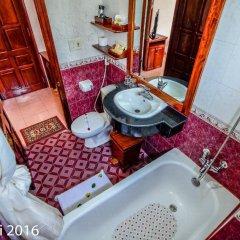 Отель Nhi Nhi 3* Номер Делюкс фото 12