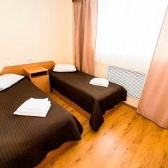 Гостиница МК комната для гостей фото 4