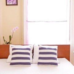 Отель City Rooms Стандартный номер с двуспальной кроватью (общая ванная комната)