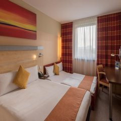 Отель Holiday Inn Express Munich Airport комната для гостей фото 3