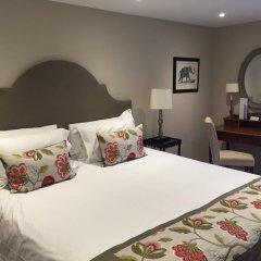 Отель Roof Garden Rooms Лондон комната для гостей фото 2