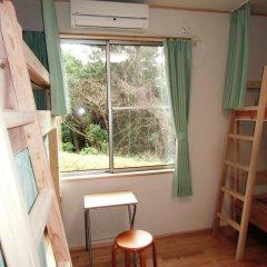 Отель Guesthouse Yakushima Якусима комната для гостей фото 5