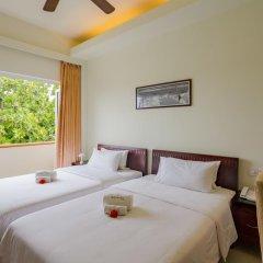 Отель Reveries Diving Village, Maldives 3* Номер Делюкс с двуспальной кроватью фото 4