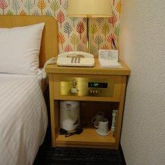 Hotel Wing International Kourakuen сейф в номере