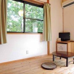 Отель Iyashi no Minshuku Tonton Якусима удобства в номере фото 2