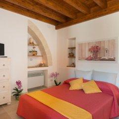Отель Grandi Trulli Bed & Breakfast Альберобелло комната для гостей фото 5