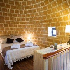 Отель Grandi Trulli Bed & Breakfast Альберобелло комната для гостей фото 3