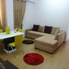Отель Toti Apartments Албания, Тирана - отзывы, цены и фото номеров - забронировать отель Toti Apartments онлайн комната для гостей фото 5