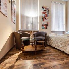 Апартаменты Queens Apartments комната для гостей фото 2