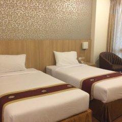 Отель Three Seasons Place комната для гостей