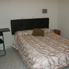 Отель JQC Rooms 2* Стандартный номер с двуспальной кроватью (общая ванная комната)