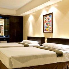 Отель M Citi Suites 3* Стандартный семейный номер с различными типами кроватей