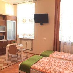 Апартаменты В Центре комната для гостей