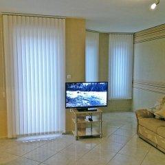Aquarelle Hotel & Villas комната для гостей