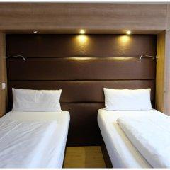Отель Motel Plus Berlin 3* Стандартный семейный номер с различными типами кроватей фото 11