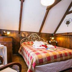 Отель Argegno Chalet Скиньяно комната для гостей фото 2