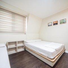 Хостел Itaewon Inn Стандартный номер с 2 отдельными кроватями фото 9