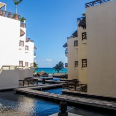 Отель Aldea Thai by Ocean Front Плая-дель-Кармен приотельная территория