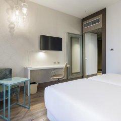 Отель NH Milano Touring 4* Улучшенный номер разные типы кроватей