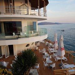 Отель Delfini Албания, Саранда - отзывы, цены и фото номеров - забронировать отель Delfini онлайн приотельная территория фото 2
