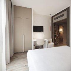 Отель NH Milano Touring 4* Улучшенный номер разные типы кроватей фото 36