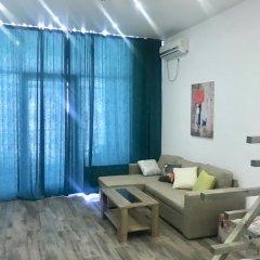 Апартаменты Apartments Deluxe Сочи комната для гостей фото 2
