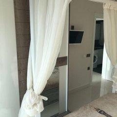 Отель Luxury Apt in Konak Sea Side with a Sea front view and a private beach сейф в номере