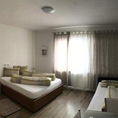 Апартаменты City Apartments Portico Меран комната для гостей фото 2