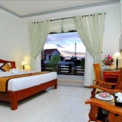 Отель Camellia Homestay 3* Улучшенный номер с различными типами кроватей фото 4