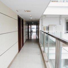 Отель Xiamen Haiwan Dushi ApartHotel Китай, Сямынь - отзывы, цены и фото номеров - забронировать отель Xiamen Haiwan Dushi ApartHotel онлайн интерьер отеля фото 2