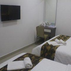 D'Metro Hotel 3* Стандартный семейный номер с двуспальной кроватью фото 4