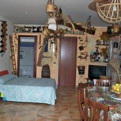 Отель Monolocale The Lair Джардини Наксос в номере