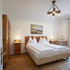 Отель Ottmanngut Suite and Breakfast Меран комната для гостей