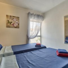 Отель Central Suites Каура комната для гостей