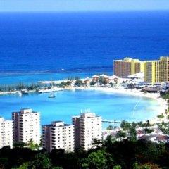 Отель Beach-side condos at Turtle Beach Towers пляж
