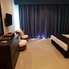 Отель East Suites Улучшенный номер с различными типами кроватей фото 3