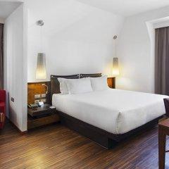 Отель NH Milano Touring 4* Стандартный номер двуспальная кровать фото 6