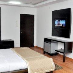 Отель Dwarka Palace Индия, Нью-Дели - отзывы, цены и фото номеров - забронировать отель Dwarka Palace онлайн удобства в номере фото 2