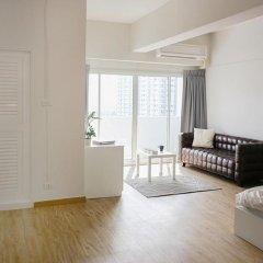 Апартаменты New Apg Apartments Бангкок комната для гостей фото 3