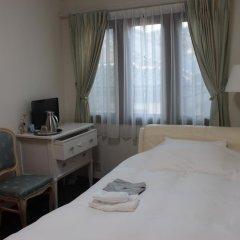 Отель La Isla Tasse Япония, Якусима - отзывы, цены и фото номеров - забронировать отель La Isla Tasse онлайн комната для гостей фото 5