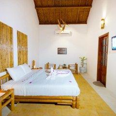 Отель Hoi An Rustic Villa 2* Номер Делюкс с различными типами кроватей фото 9