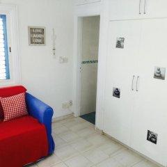 Апартаменты Ikaria Village Studio сейф в номере