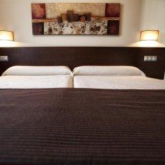 Отель Apartamentos Rurales L'Arquera сейф в номере