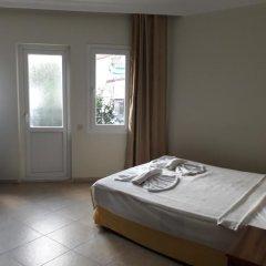 Akdeniz Beach Hotel Турция, Олюдениз - 1 отзыв об отеле, цены и фото номеров - забронировать отель Akdeniz Beach Hotel онлайн комната для гостей фото 3