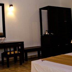 Отель Lotus Paradise Health Resort Шри-Ланка, Ахунгалла - отзывы, цены и фото номеров - забронировать отель Lotus Paradise Health Resort онлайн удобства в номере фото 2