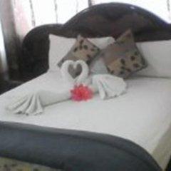 Отель Norman's Court Resort & Sky Restaurant Club Ямайка, Монтего-Бей - отзывы, цены и фото номеров - забронировать отель Norman's Court Resort & Sky Restaurant Club онлайн комната для гостей фото 2