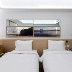 Отель Sotetsu Hotels The Splaisir Seoul Myeong-Dong 4* Улучшенный номер с различными типами кроватей фото 4